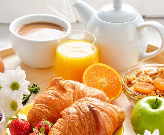 56405474 - breakfast tray in bed in hotel room.
